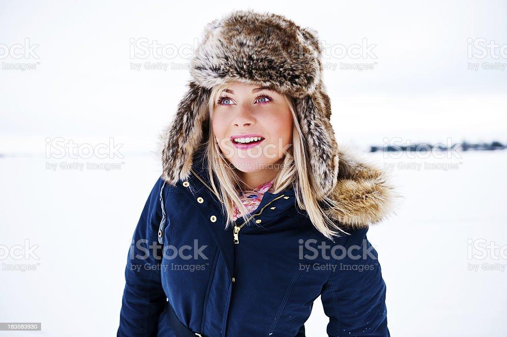 Fashionable woman outside smiling royalty-free stock photo