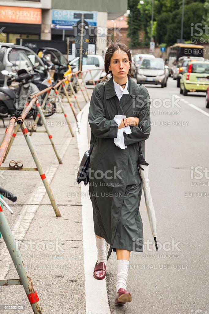 Fashionable woman posing during Milan Fashion Week stock photo