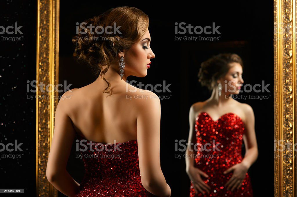 fashionable woman posing in front of mirror stock photo