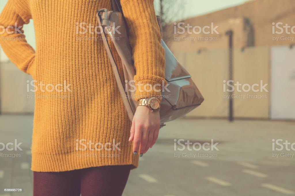 Fashionable woman posing on the street. stock photo