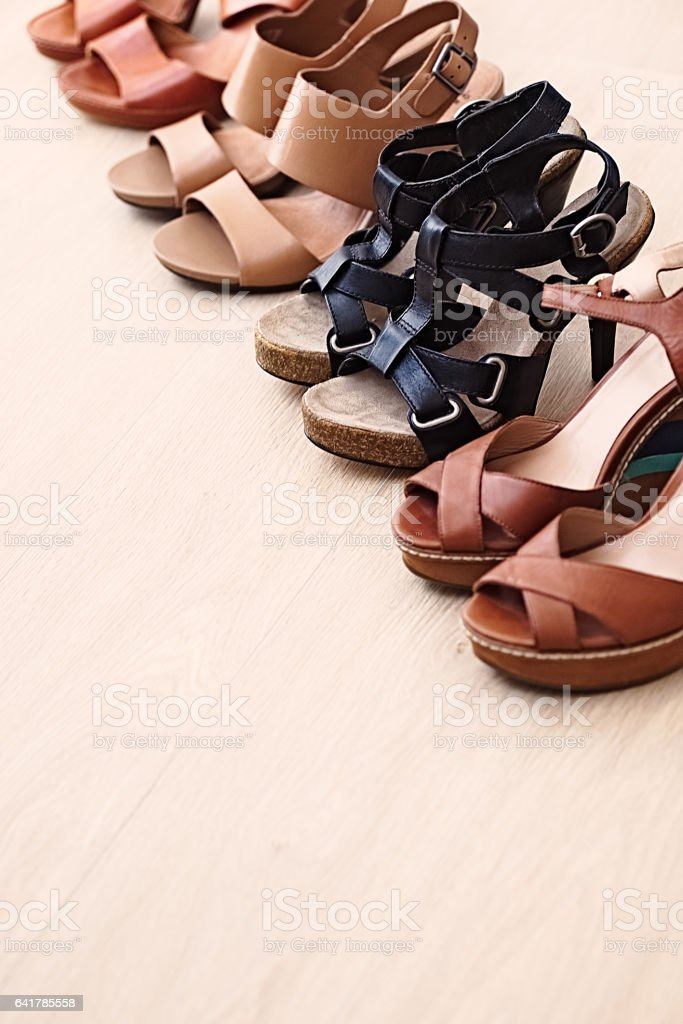 Fashionable woman shoes - brown and black sandals stock photo