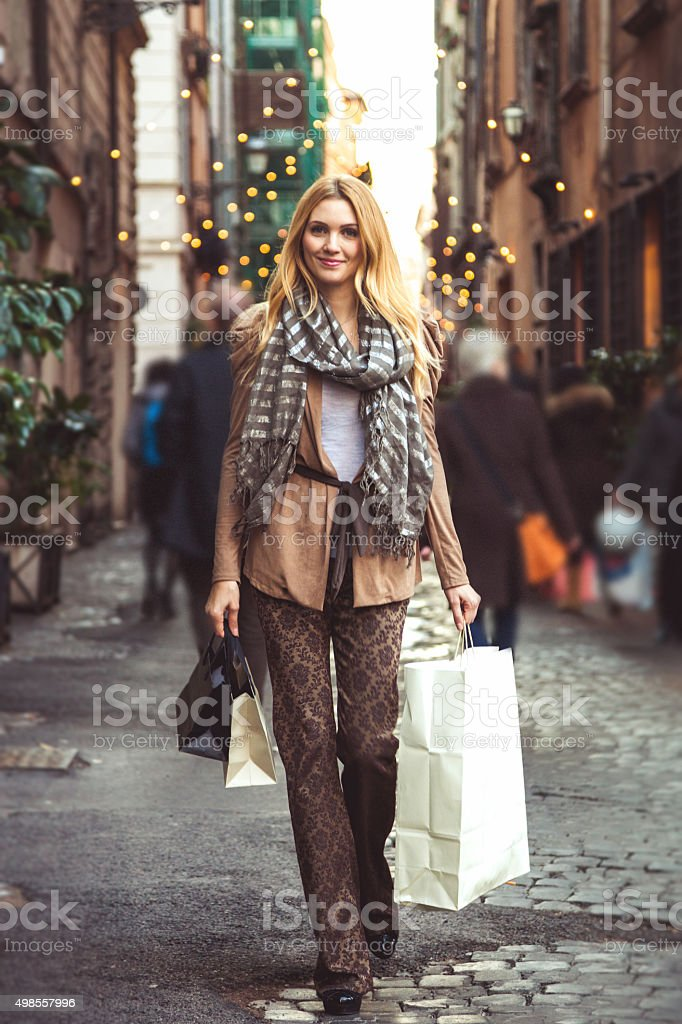 Fashionable woman shopping in central Rome stock photo