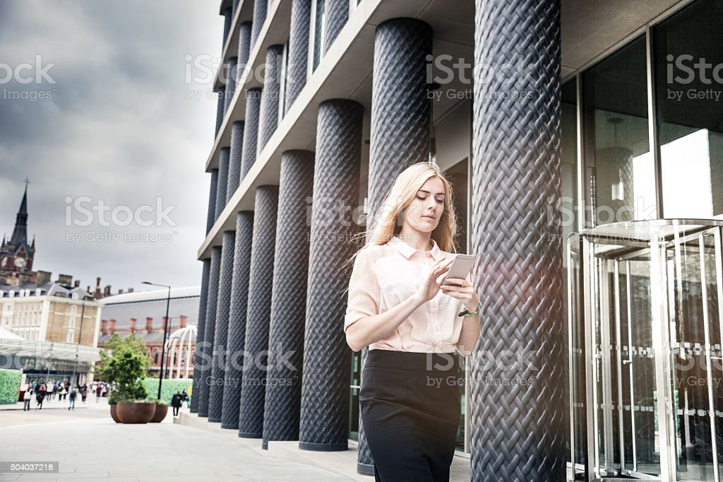 Fashionable woman walking in Central London stock photo