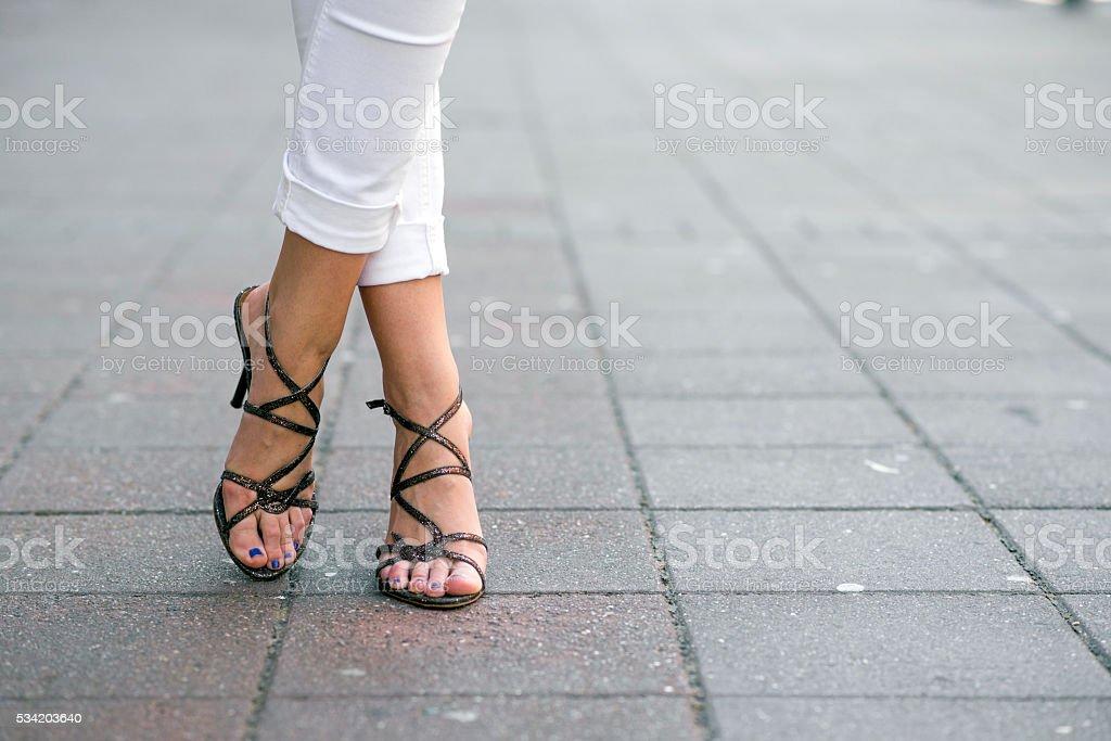 Fashionable woman wearing high heel shoes stock photo