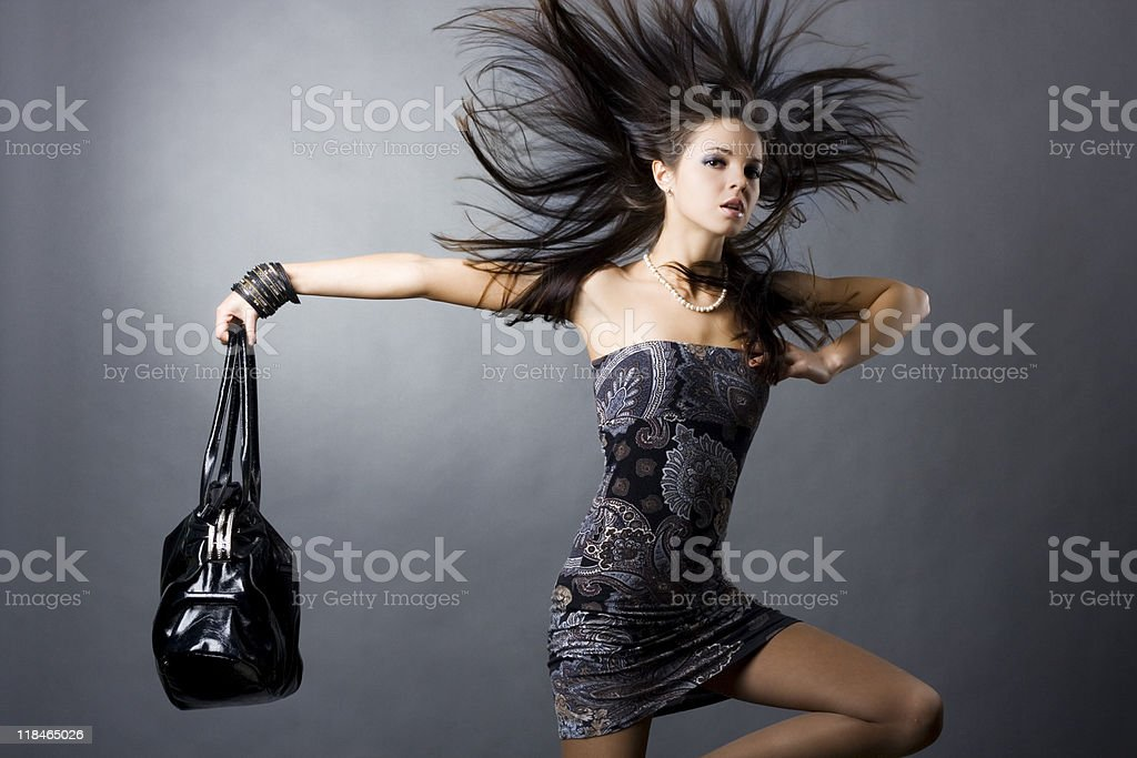 Fashionable woman with a black handbag royalty-free stock photo
