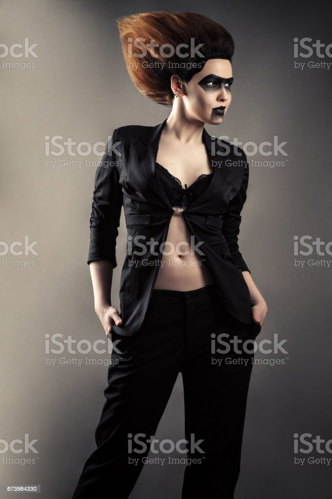 fashionable woman with dark makeup in business suit stock photo