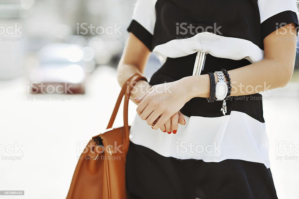 Fashionable woman with handbag in hands - close up stock photo