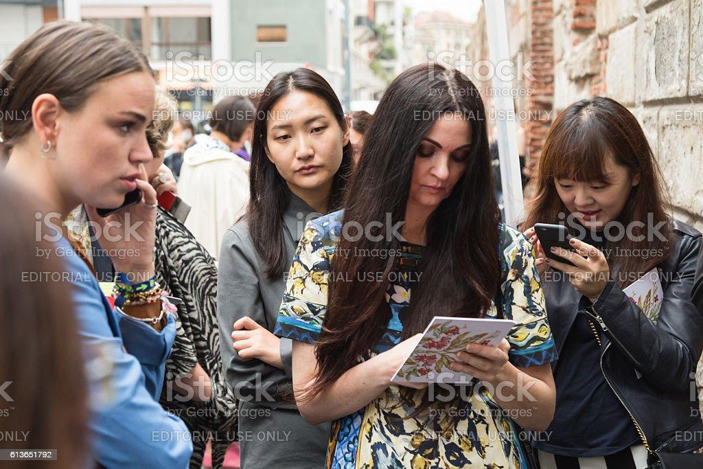 Fashionable women posing during Milan Fashion Week stock photo