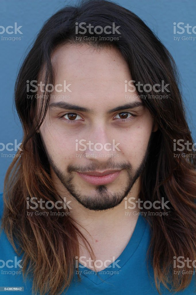 Fashionable young man with a trendy long hair stock photo