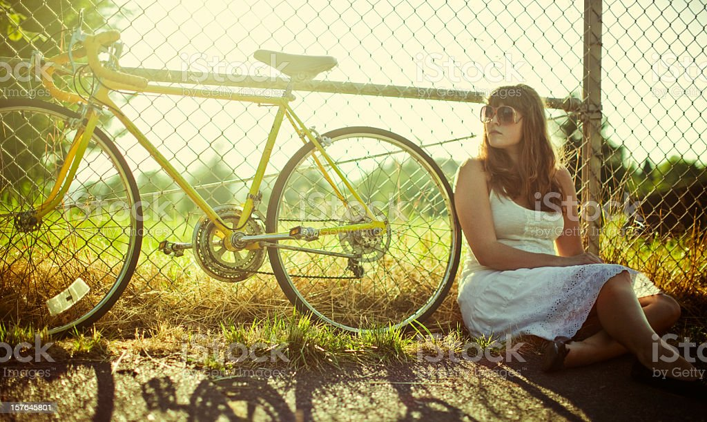 Fashionable Young Woman and Bike royalty-free stock photo
