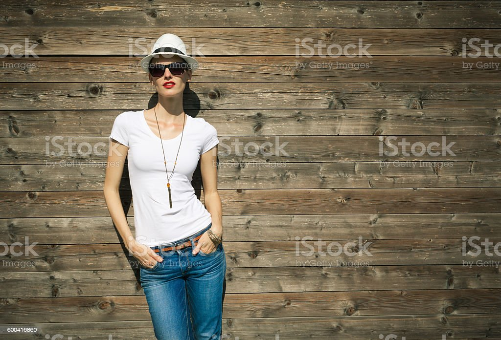 Fashionable young woman in jeans and white shirt stock photo