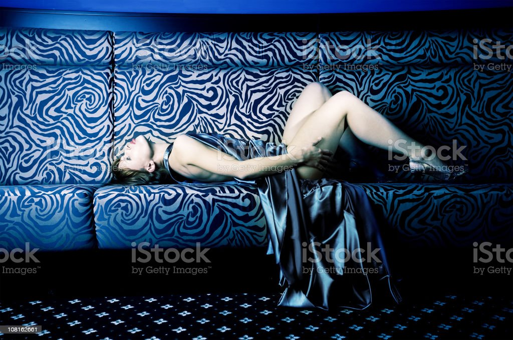 Fashionable Young Woman Laying on Sofa royalty-free stock photo
