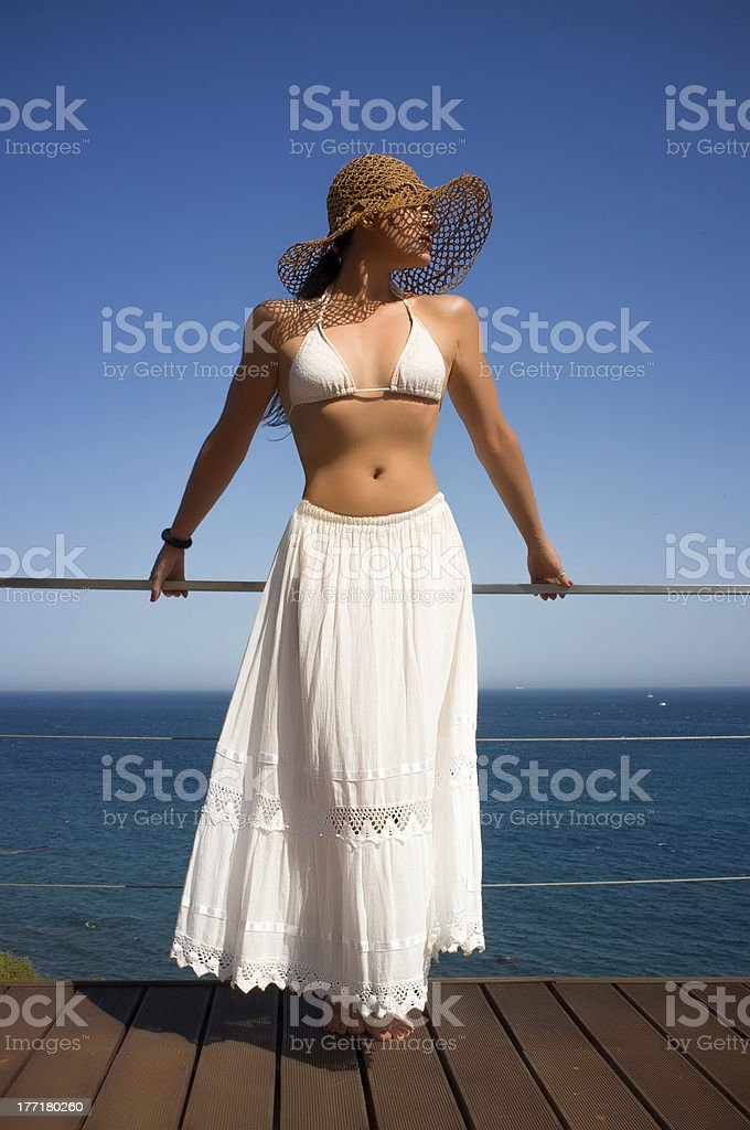 Fashionable Young Woman on Summer Vacation. Girl in White royalty-free stock photo