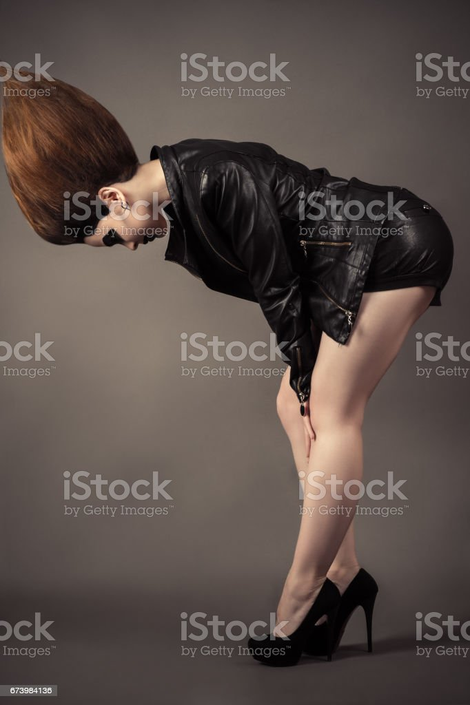 fashionable young woman with lush hair stock photo