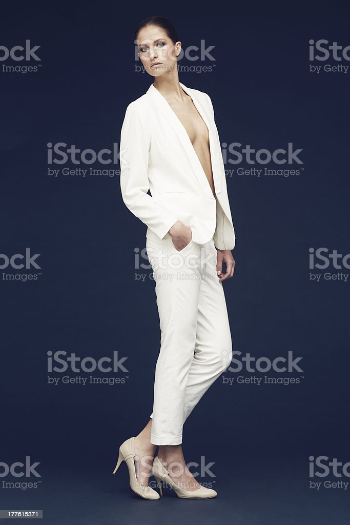 fashionshot of a model in white jacket against blue background royalty-free stock photo