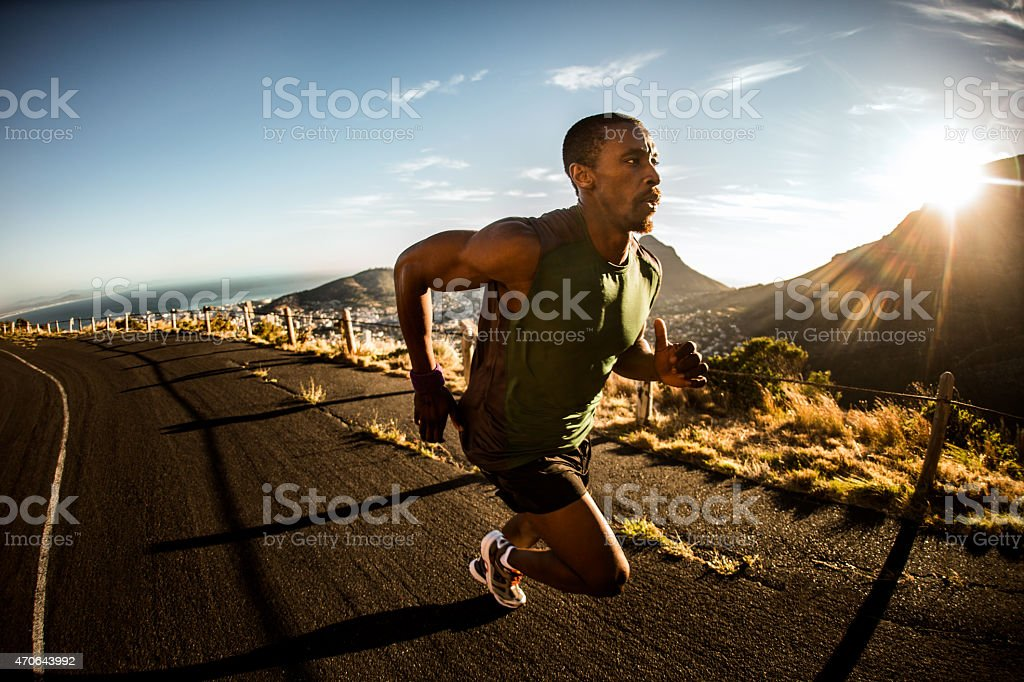 Fast African American athlete sprinting during fitness training stock photo