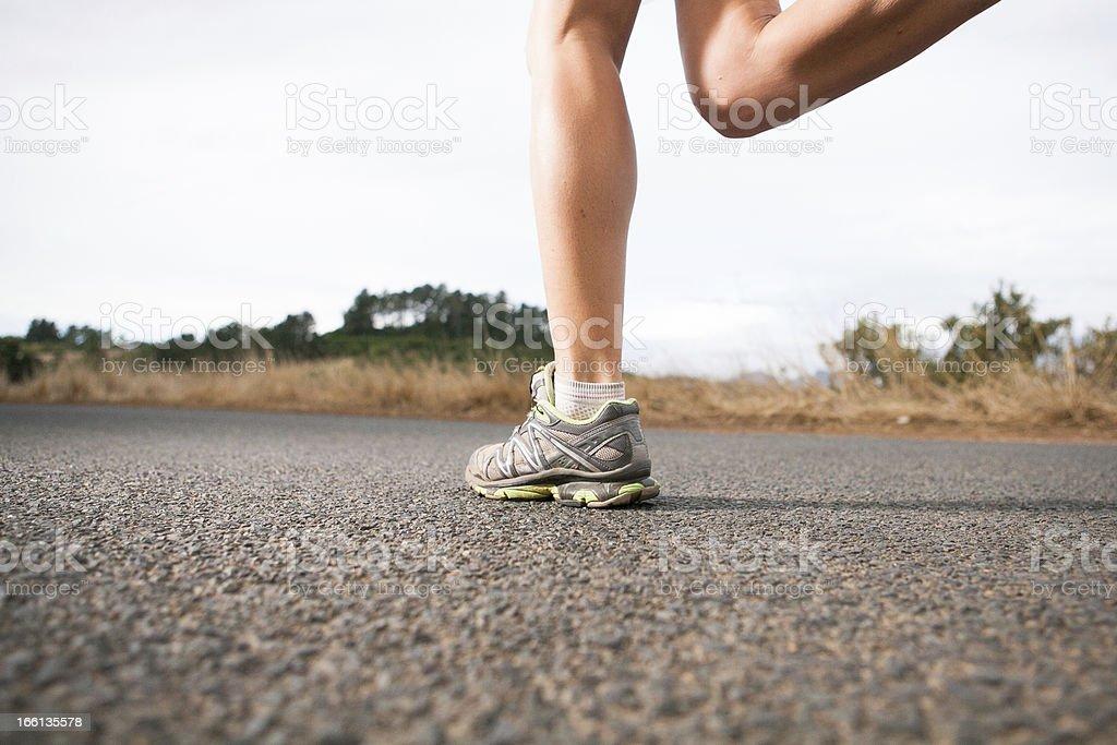 Fast athlete landing for next stride stock photo