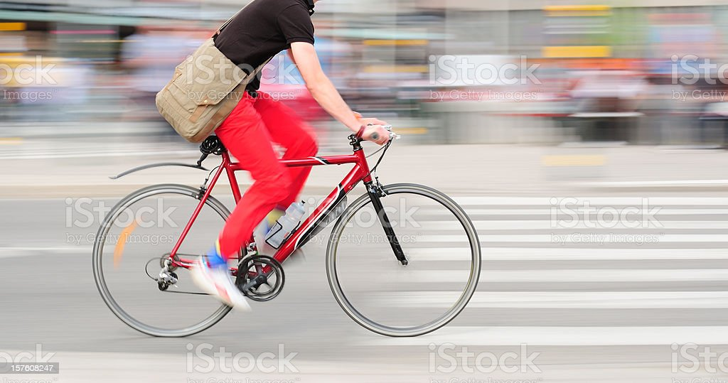 Fast bike motion blurred in traffic royalty-free stock photo