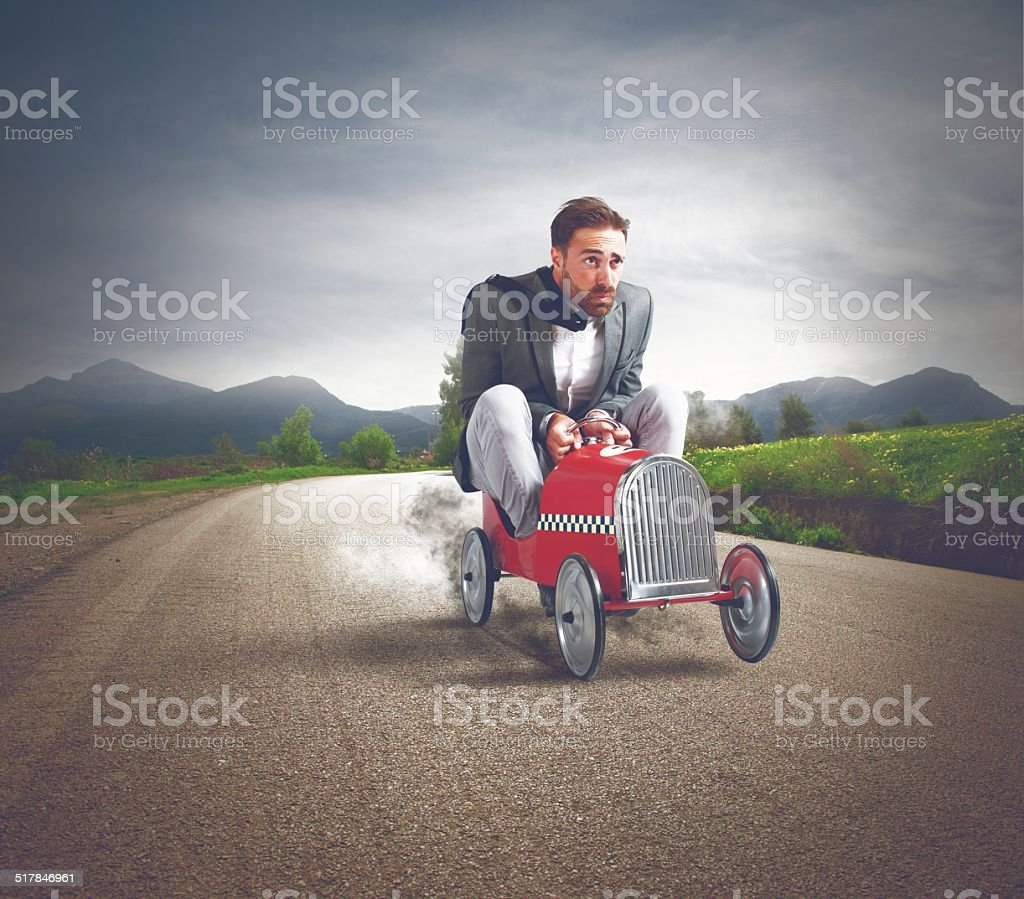 Fast business with driving businessman stock photo
