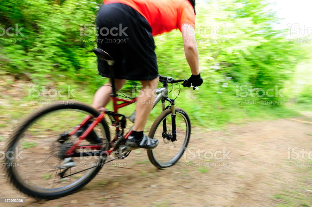 Fast downhill biker royalty-free stock photo