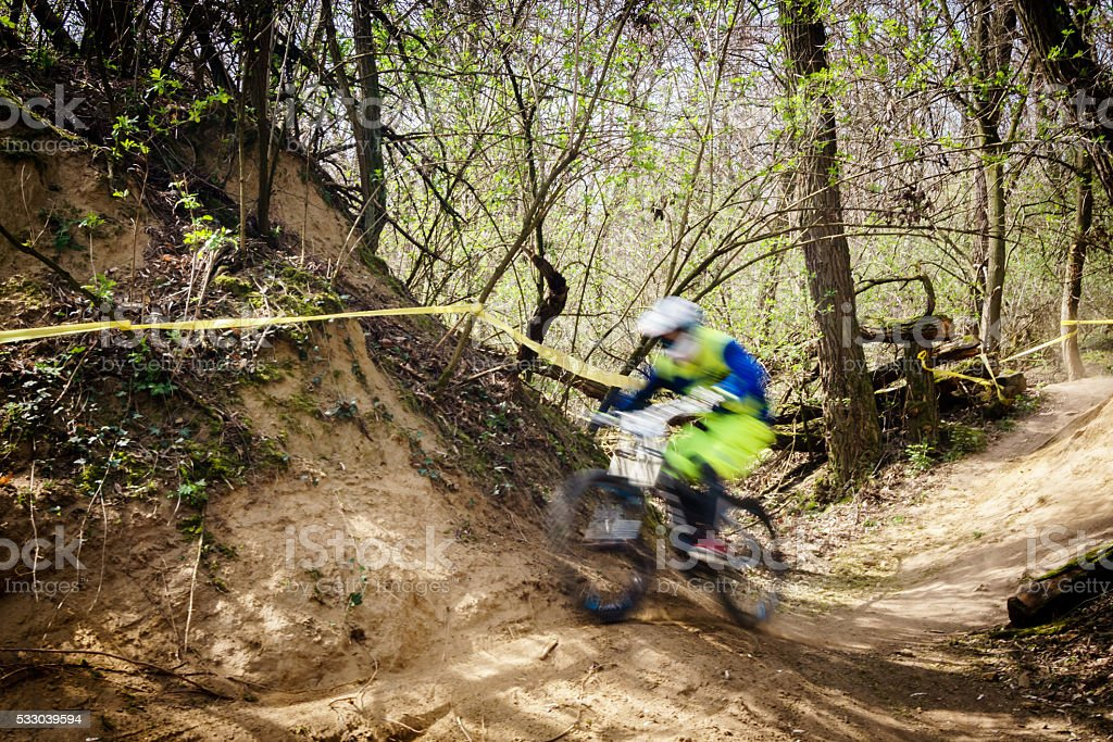 fast downhill mountain bike racing stock photo