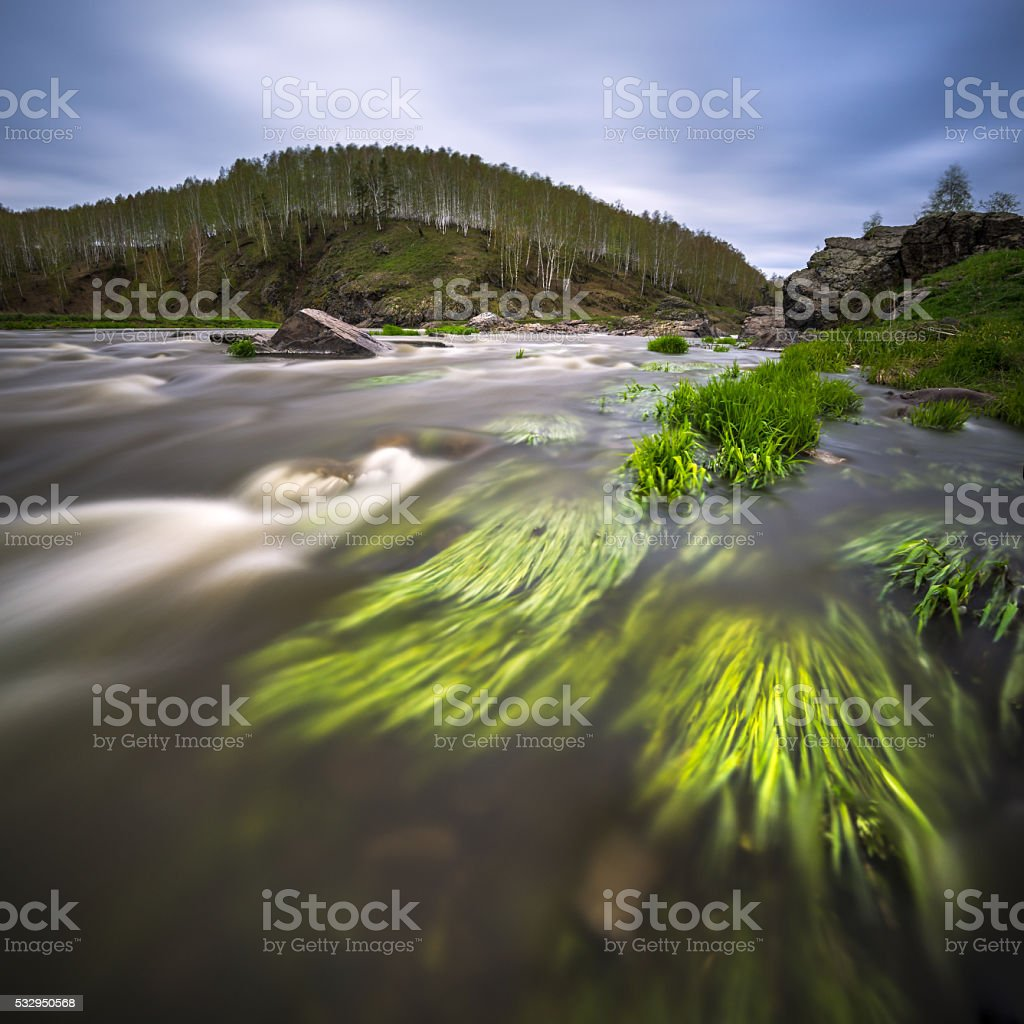 fast flowing mountain river stock photo