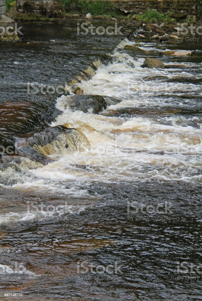 Fast Flowing River Weir. stock photo
