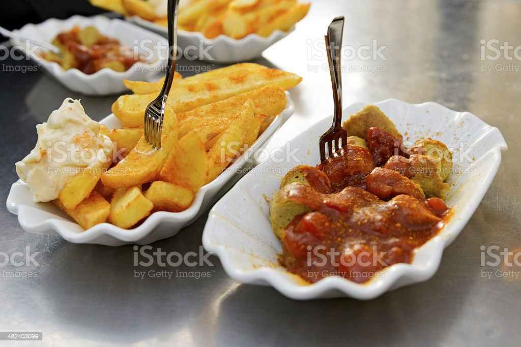 Fast food currywurst and fries stock photo