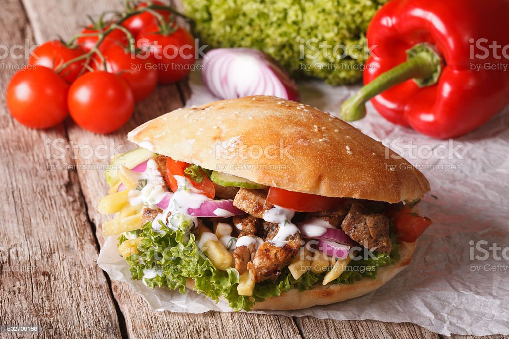 Fast Food: Doner kebab with meat, vegetables and french fries stock photo