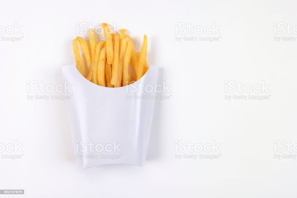 Fast food french fries isolated on white background. stock photo