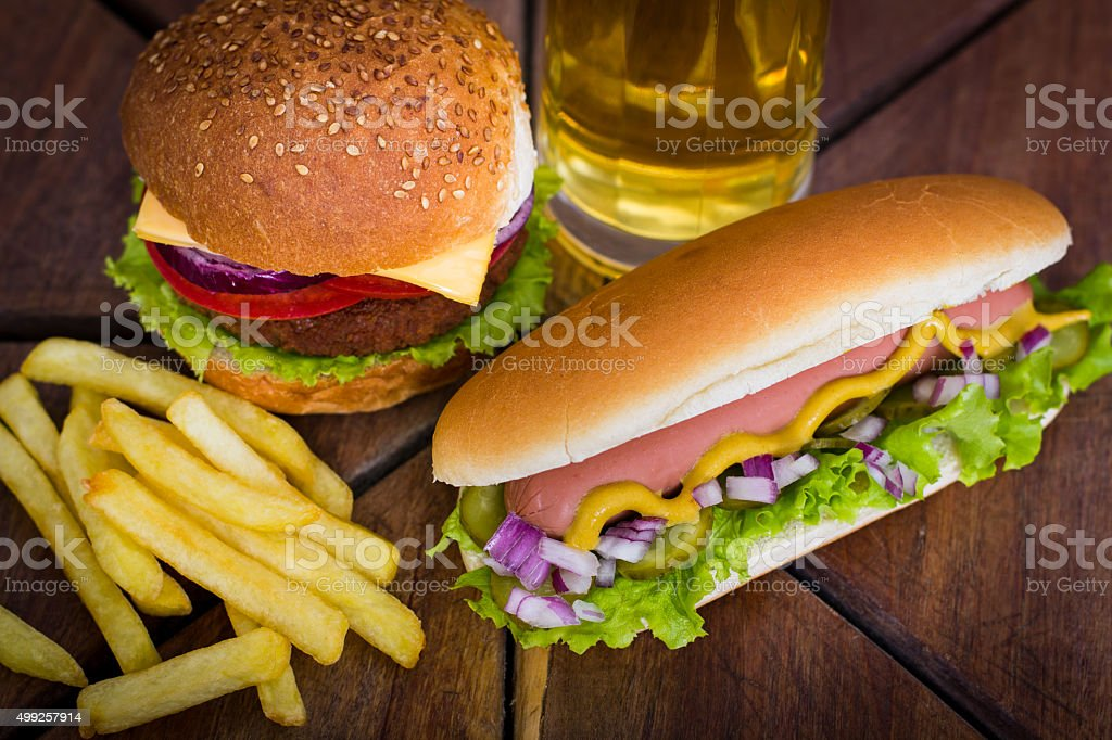Fast food - Hot dogs, hamburger and French fries stock photo