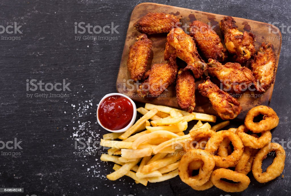 fast food meals : onion rings, french fries and fried chicken stock photo