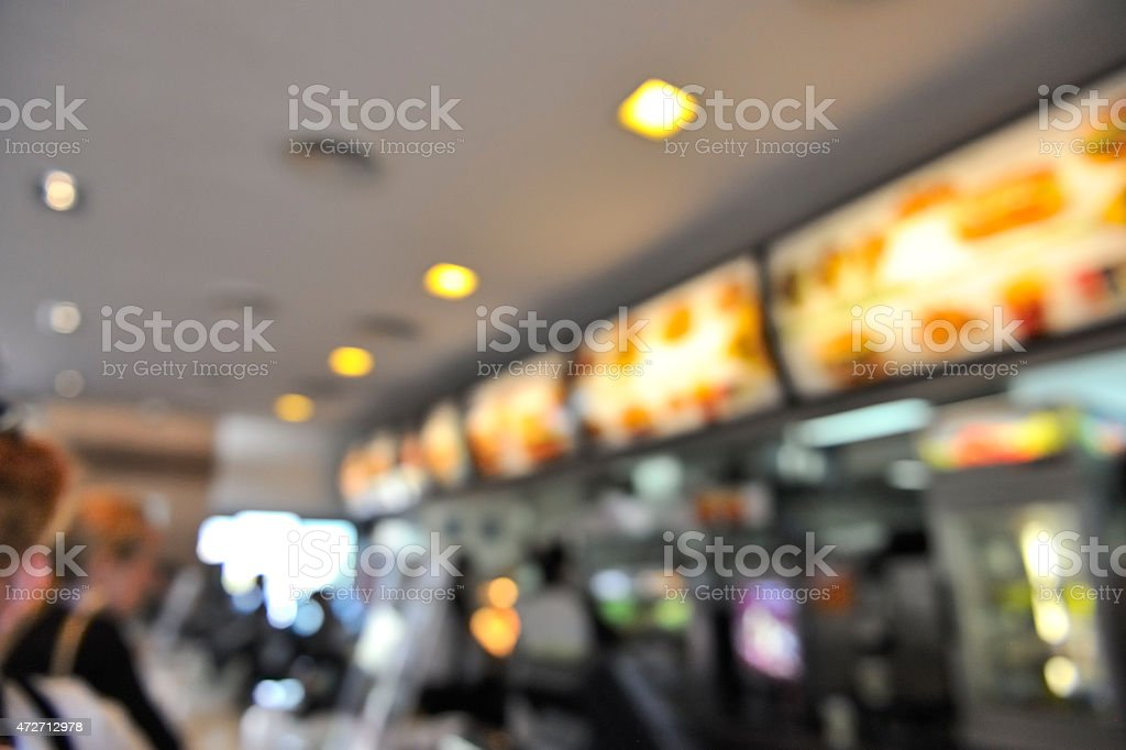 Fast food restaurant interior menu bokeh background stock photo