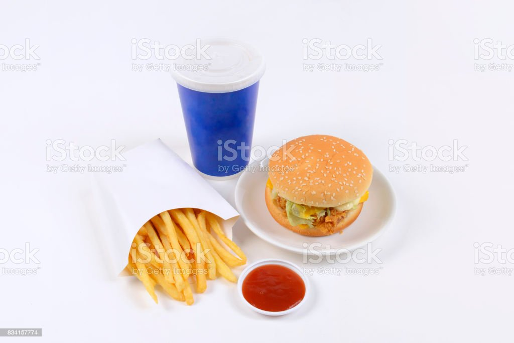 Fast food set containing burgers, french fries and soft drink isolated on white background. stock photo