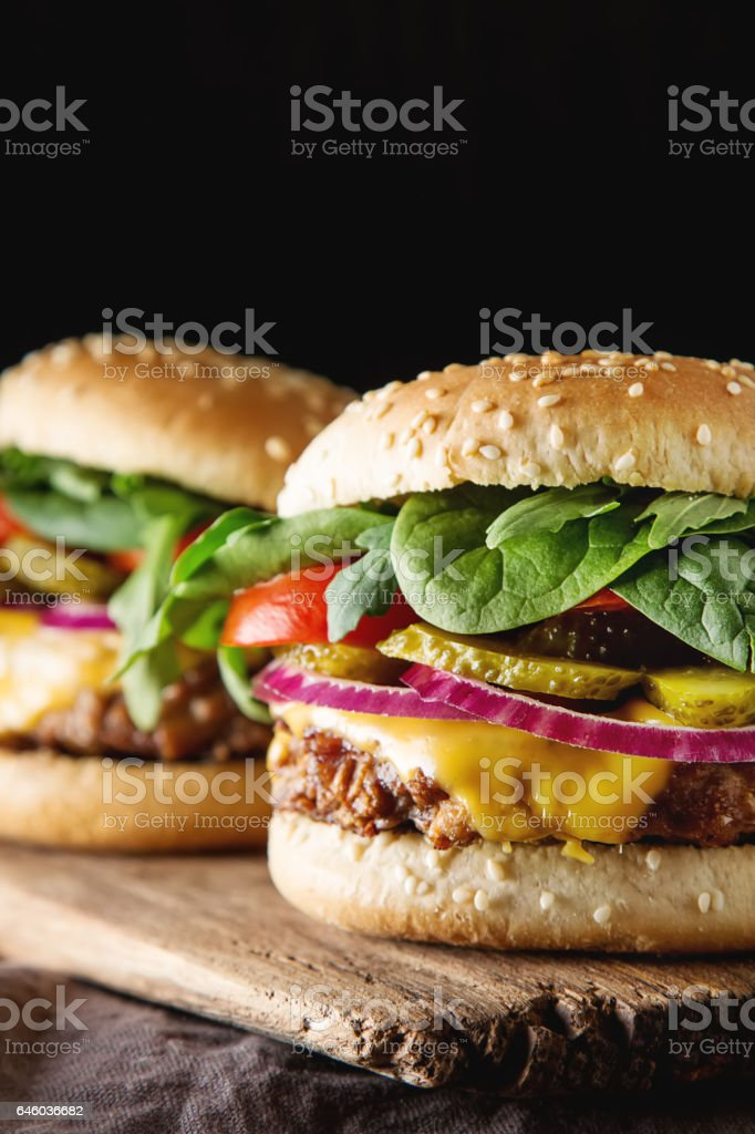 Fast food. Vegetarian burger with a chop, cucumber, tomato and l stock photo