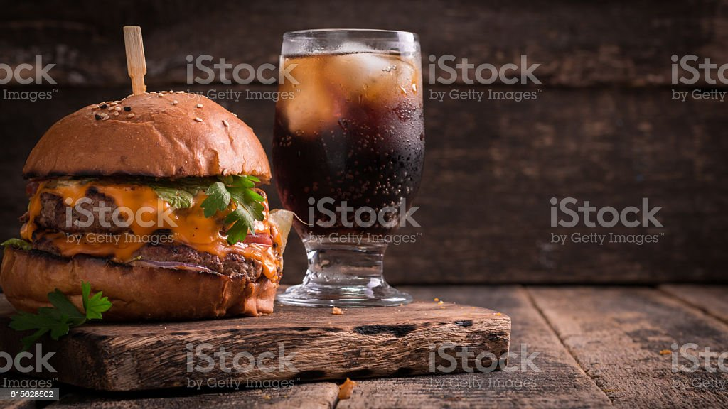 fast food with burger or cheeseburger, and soft drink on vintage...