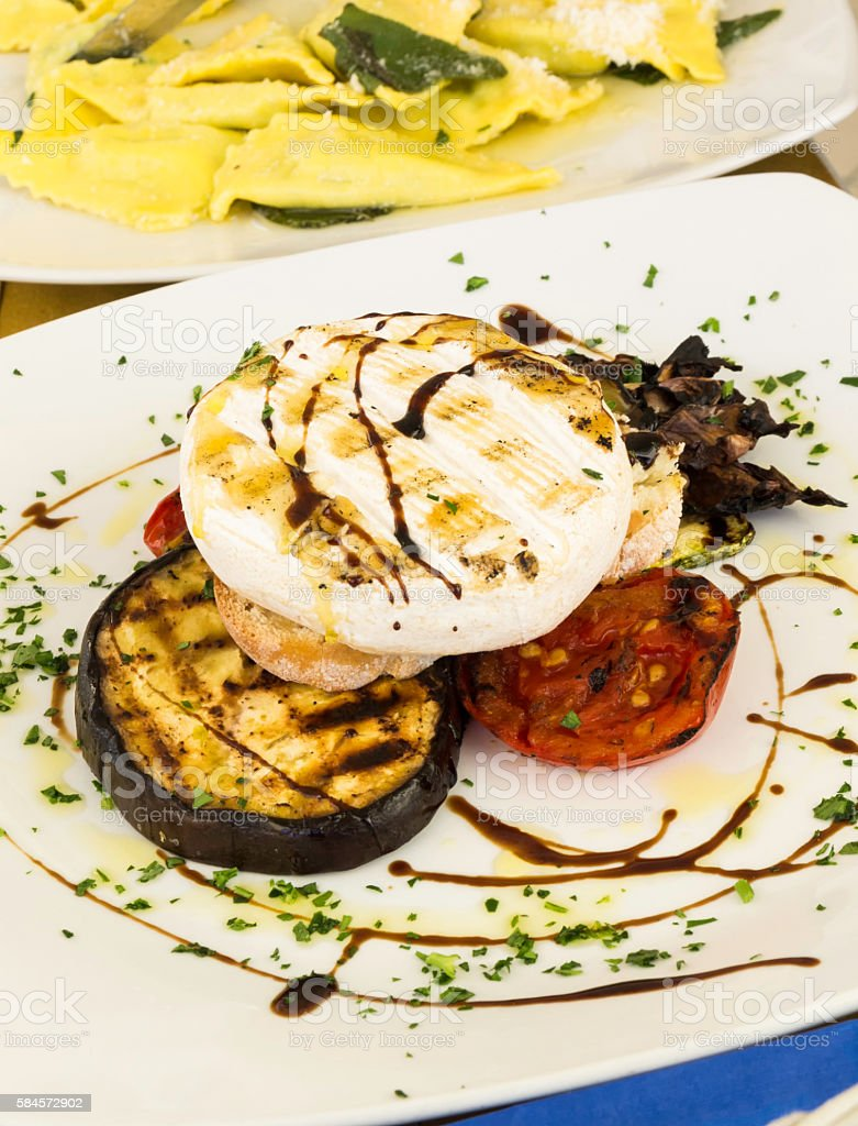 Fast food with grilled tomino, aubergine and tomato stock photo