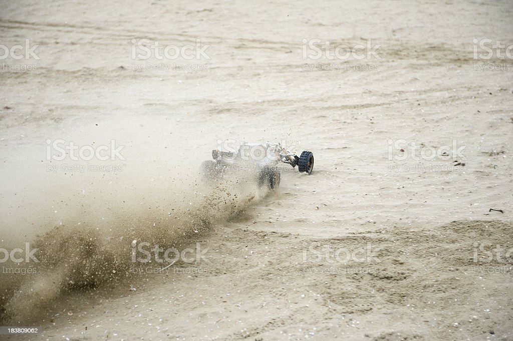 fast going remote controlled car at the beach stock photo