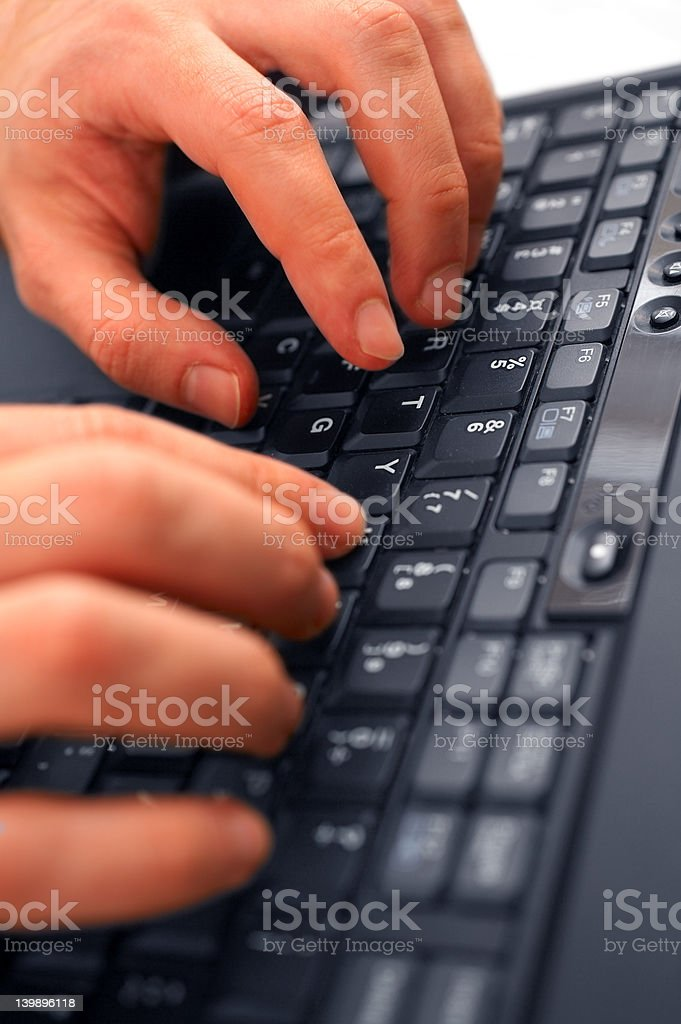 Fast hands typing on Laptop royalty-free stock photo