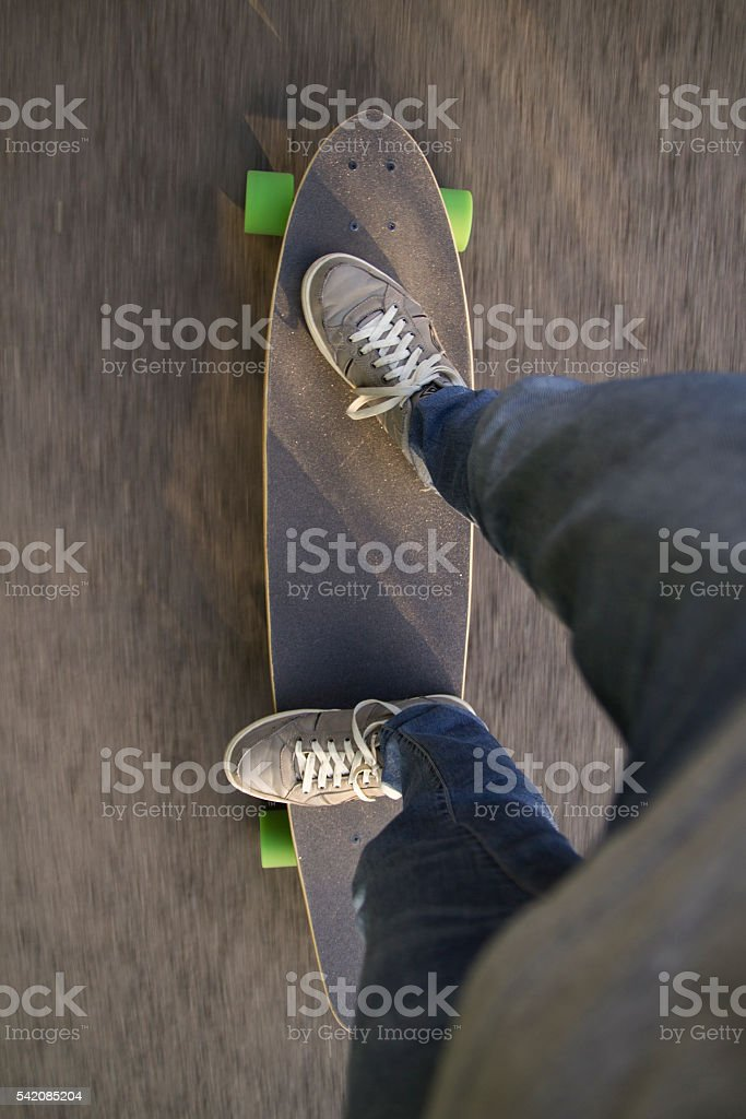 Fast longboard riding, top view. stock photo
