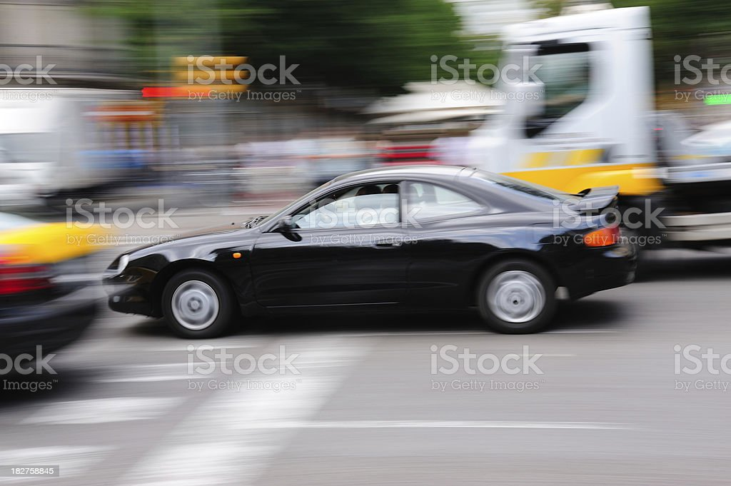 Fast motion blurred car in heavy traffic royalty-free stock photo
