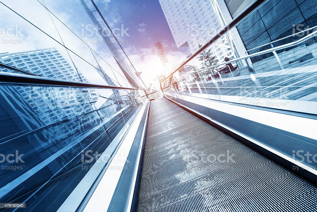 fast motion of escalator with sunbeam stock photo