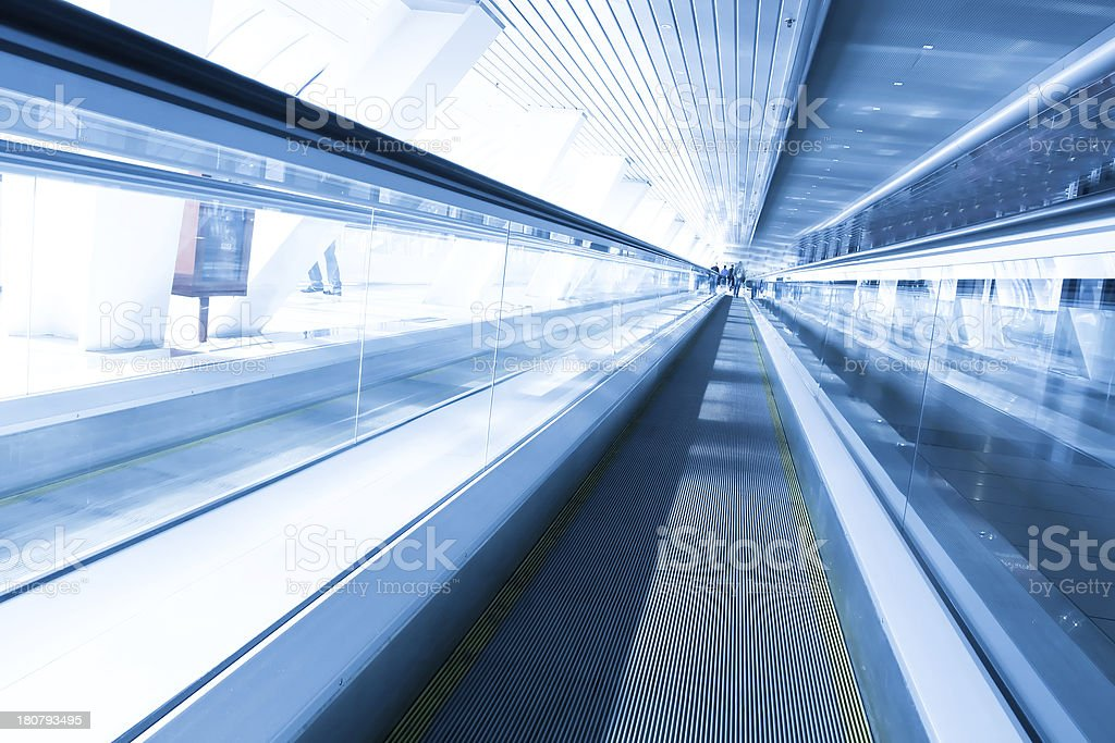 fast moving escalator by motion royalty-free stock photo