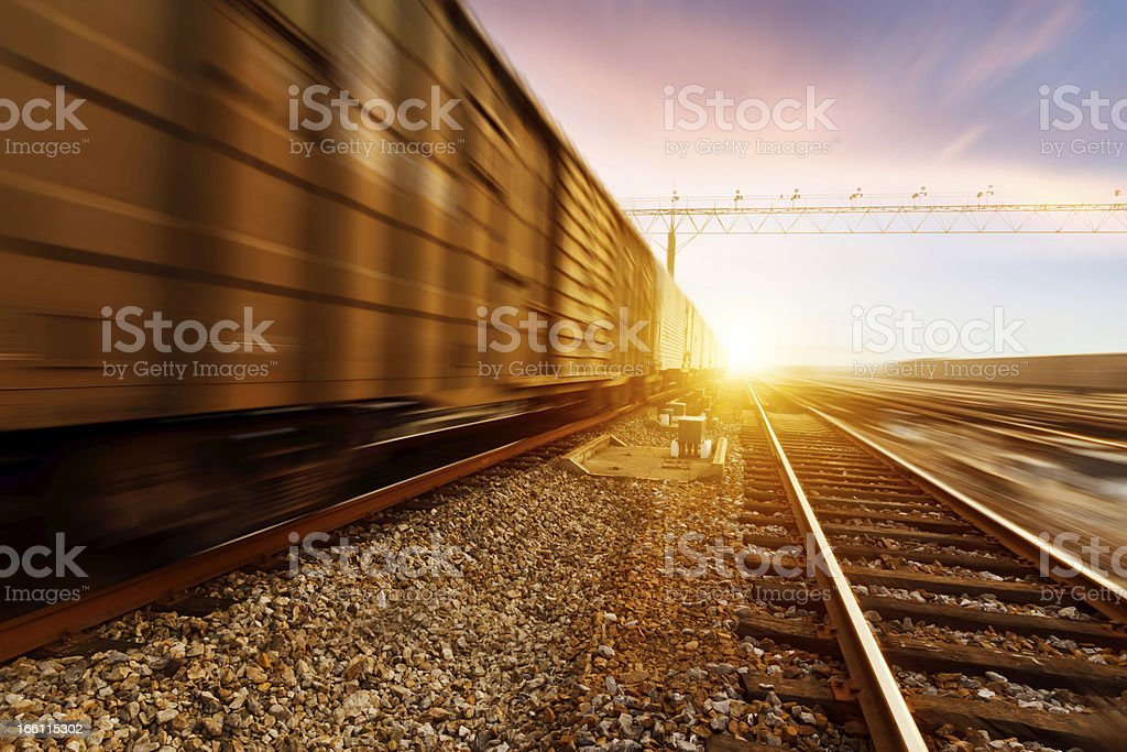 fast moving freight train, drawing out of the station stock photo