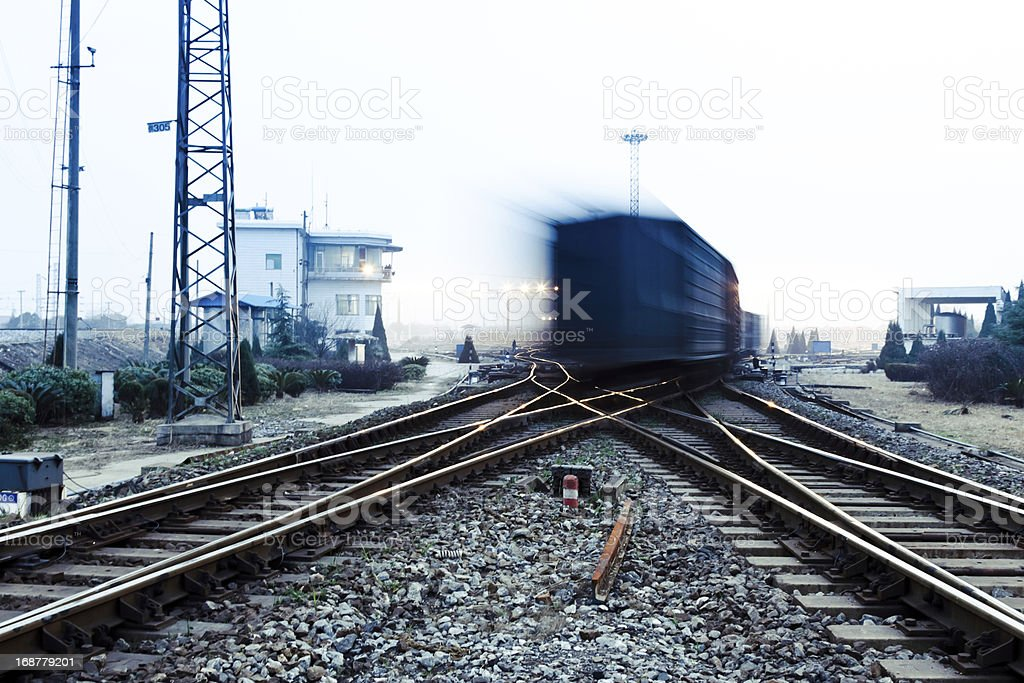fast moving freight train, drawing out of the station royalty-free stock photo