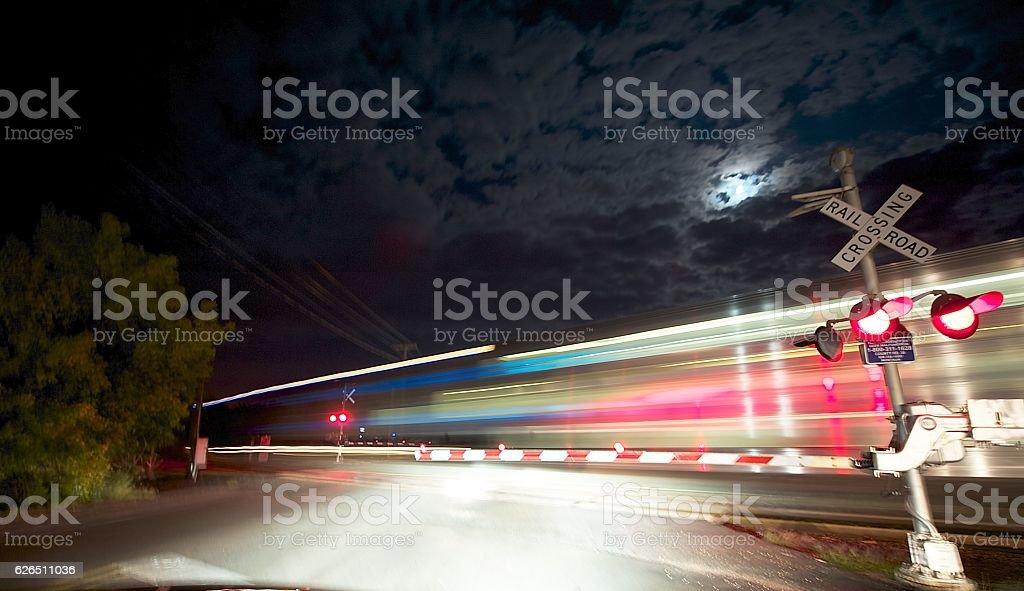 Fast Night Train at Crossing stock photo