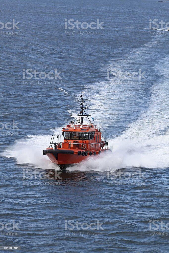 Fast orange and black pilot boat in Sweden blue sea stock photo