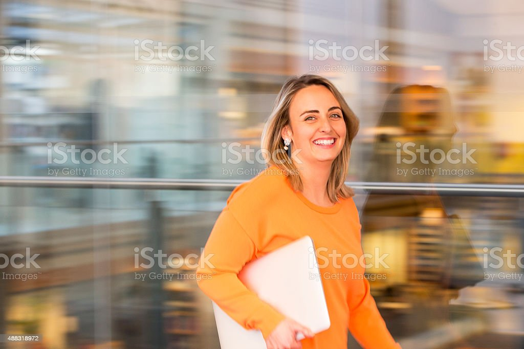 Fast Paced Businesswoman stock photo