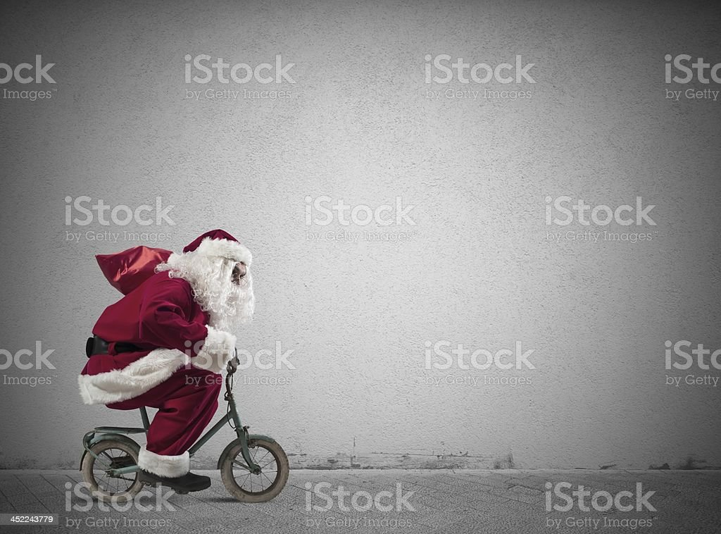 Fast Santa Claus on the bike stock photo