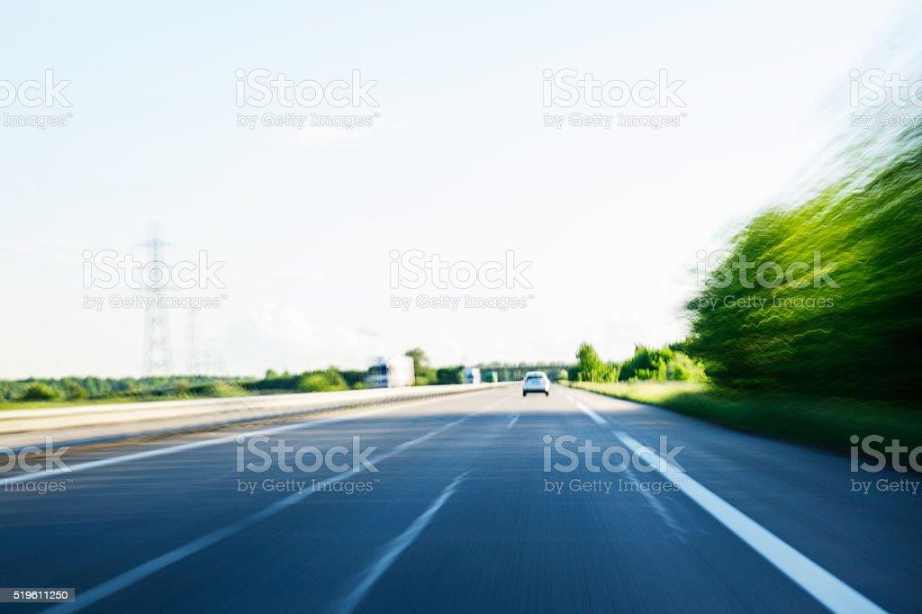 Fast speeding car on highway POV stock photo